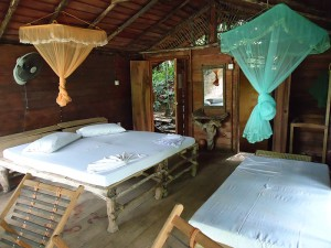 Our room at the ecolodge. For some reason they gave us three beds.